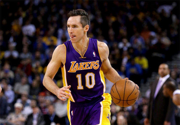 Steve Nash dribbles up the court in his first game back since injuring his leg on Oct. 31.