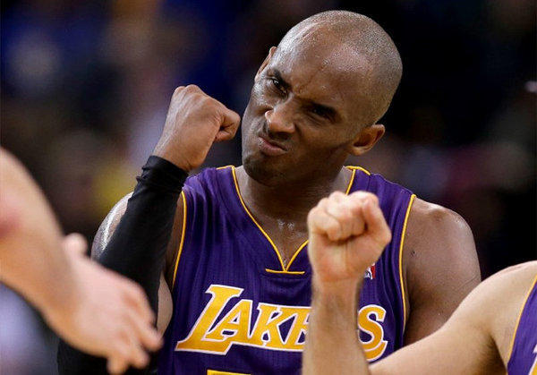 Kobe Bryant celebrates after the Lakers beat the Warriors in overtime.