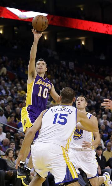 Steve Nash shoots over Warriors big man Andris Biedrins on Saturday.