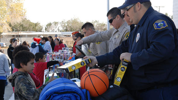 Imperial County public safety officials hand out toys to needy children at the Marine Corps Toys for Tots on Saturday morning at Grace Smith Elementary School in Niland.