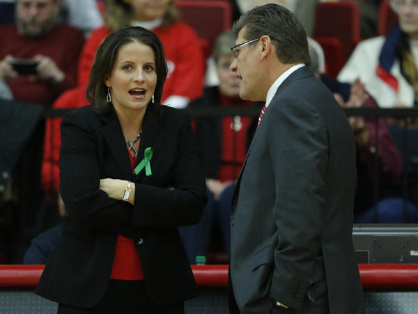 Hartford Hawks head coach Jennifer Rizzotti talks with Connecticut Huskies head coach Geno Auriemma before the game at the Chase Family Arena.