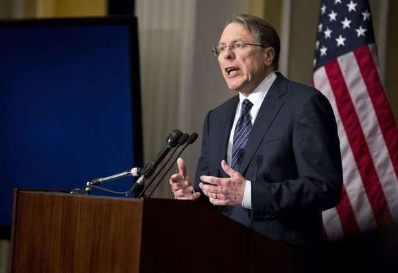 Wayne LaPierre, NRA spokesman, says a police officer should be posted in every school.