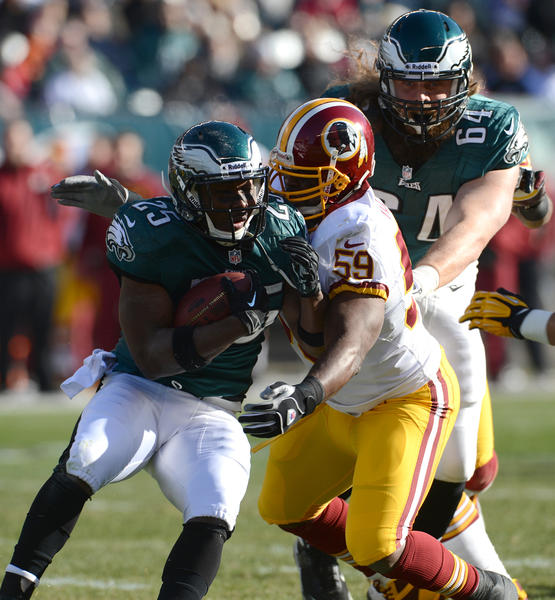 Philadelphia Eagles running back LeSean McCoy (25) attempts to run the football as Washington Redskins inside linebacker London Fletcher (59) looks to make the tackle at Lincoln Financial Field in Philadelphia on Sunday.