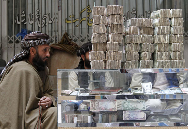 An Afghan dealer waits for customers at a money market in Kandahar.