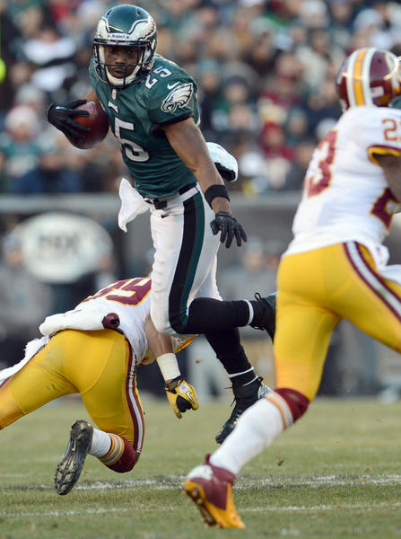 Philadelphia Eagles running back LeSean McCoy (25)] leaps over Washington Redskins inside linebacker London Fletcher (59)  at Lincoln Financial Field in Philadelphia on Sunday.
