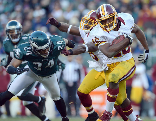 Washington Redskins running back Alfred Morris (46) runs by Philadelphia Eagles cornerback Nnamdi Asomugha (24)  at Lincoln Financial Field in Philadelphia on Sunday.