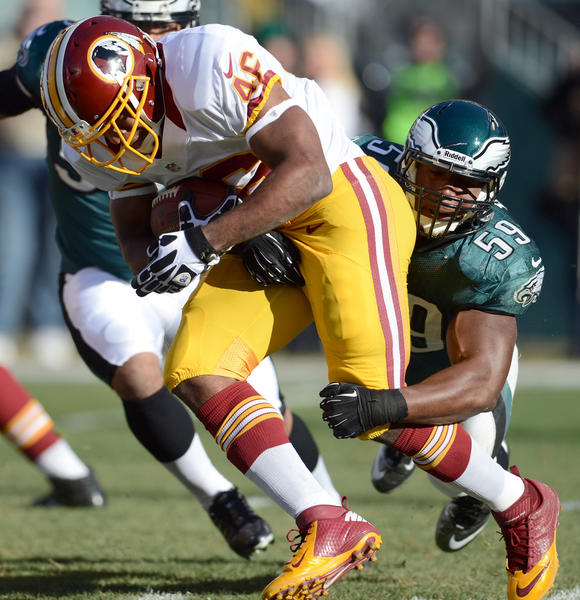 Philadelphia Eagles middle linebacker DeMeco Ryans (59) tackles Washington Redskins running back Alfred Morris (46)  at Lincoln Financial Field in Philadelphia on Sunday.