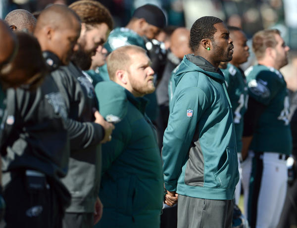 Philadelphia Eagles quarterback Michael Vick (7) during a moment of silence for the Newtown before their game against the Washington Redskins  at Lincoln Financial Field in Philadelphia on Sunday.