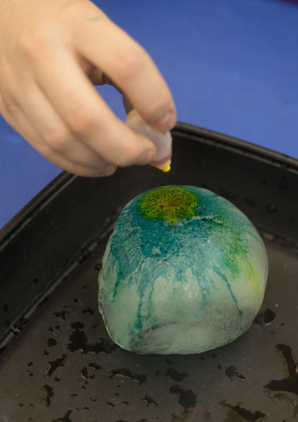 Science Education Justin Brown drops food coloring into frozen salt water during the new Polar Science Adventures inside the Da Vinci Science Center in Allentown on Sunday. Polar Science Adventures includes two rooms of activities and a series of stage shows.