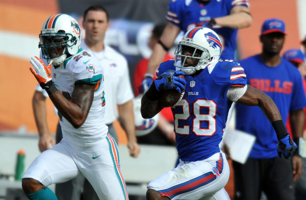 Buffalo Bills running back C.J. Spiller (28) runs past Miami Dolphins cornerback Sean Smith (24) during the first half at Sun Life Stadium. Mandatory Credit: