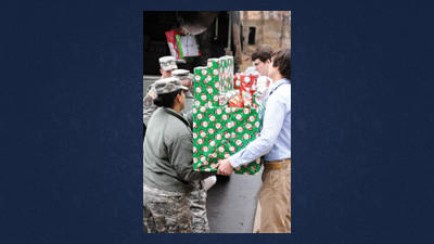 Pennsylvania National Guard helping students with gift boxes are front: Adam Wood and Gap Barbin, seniors at BMCHS.