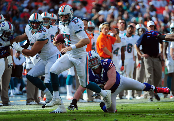 Miami Dolphins  Ryan Tannehill outruns     Buffalo Bills Kyle Williams during the second quarter, Sunday, Dec. 23, 2012, at Sun Life Stadium in Miami Gardens.