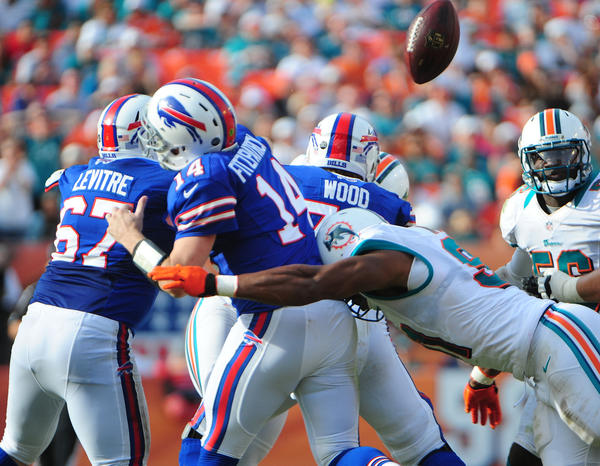 Miami Dolphins Cameron Wake knocks the ball loose from the Buffalo Bills quarterback Ryan Fitzpatrick during the third quarter, Sunday, Dec. 23, 2012, at Sun Life Stadium in Miami Gardens.