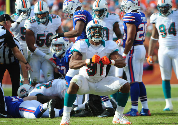 Miami Dolphins Cameron Wake celebrates a sack and fumble recovery of the Buffalo Bills quarterback Ryan Fitzpatrick during the third quarter, Sunday, Dec. 23, 2012, at Sun Life Stadium in Miami Gardens.