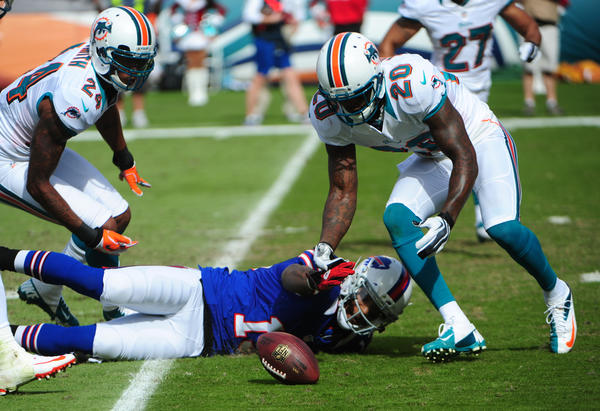 Miami Dolphins Reshad Jones recovers a fumble by Buffalo Bills Stevie Johnson during the first quarter, Sunday, Dec. 23, 2012, at Sun Life Stadium in Miami Gardens.