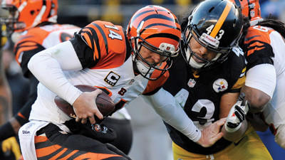Cincinnati Bengals quarterback Andy Dalton is sacked by Pittsburgh Steelers strong safety Troy Polamalu in the third quarter on Sunday.