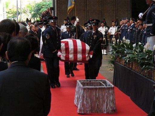 Pallbearers carry the casket of Sen. Daniel K. Inouye (D-Hawaii) into the courtyard of Hawaii's state Capitol during a ceremony in Honolulu the day before his funeral.