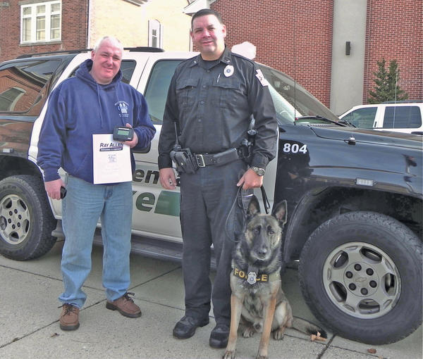 PA K9 Assistance Foundation President Mike Decher, left, holds a heat sensor that his foundation donated to Greencastle, Pa., Officer Keith Russell to keep K9 officer Rony safe from heat exhaustion.