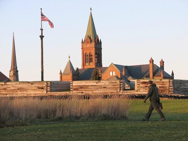 A service ranger walks past Fort Stanwix in Rome, NY. Source: Robert Brauchle