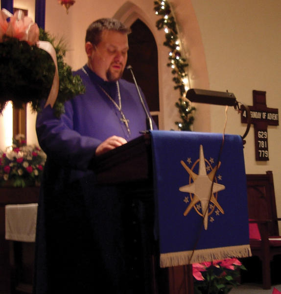 Virgil Cain, pastor at Trinity Lutheran Church in Smithsburg, leads a vesper service Sunday night to help people cope with the shootings at a Newtown, Conn. elementary school on Dec. 14.