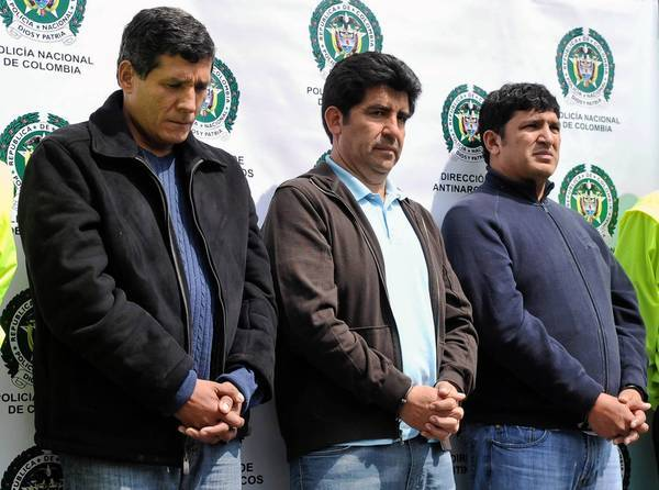 Jose Fernando Lopesierra, left, and brothers Diego and Enrique Baez are presented to the media in Bogota in March 2011. The brothers' criminal organization smuggled an average of 5 tons of cocaine a month to Central America and Mexico, U.S. law enforcement sources say.