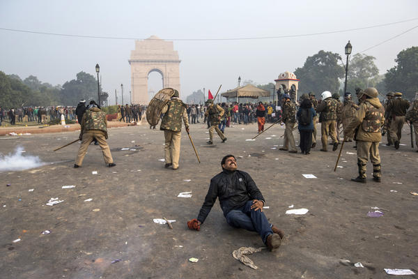 A protestor grimaces after being lathi charged by Delhi police during a protest against the Indian governments reaction to recent rape incidents in India, in front of India Gate on December 23, 2012 in New Delhi, India. The gang rape of a 23-year-old paramedical student in a moving bus on December 16, in Delhi, has led to people to react openly against the governments current rape laws. Over a thousand protesters gathered in front of Delhi to protest against lax laws and the governments handling of recent rape cases all over India.
