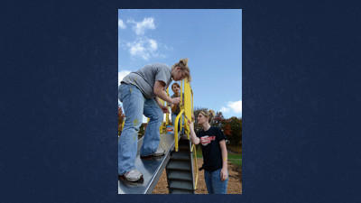 The Meyersdale Parks and Recreations board and about 60 Meyersdale high school students worked to clean up the Paul E. Fuller Playground in Meyersdale Borough. Tessa Engle, Bethany Reddick and Paige Yutzy painted one of the parks slides Oct. 4.