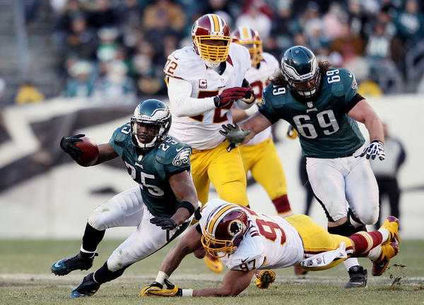 Lorenzo Alexander #97 of the Washington Redskins tackles LeSean McCoy #25 of the Philadelphia Eagles at Lincoln Financial Field on December 23, 2012 in Philadelphia, Pennsylvania. Washington won 27–20.