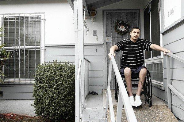 Larney Johnson, 21, on the porch of his Los Angeles home. In 2006 he had emergency surgery after being shot. Surgeons had mistakenly left a sponge inside him.