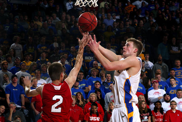 Nate Wolters of South Dakota State scores over Jordan Boots of the University of South Dakota last season. South Dakota State University Relations Photo by Eric Landwehr