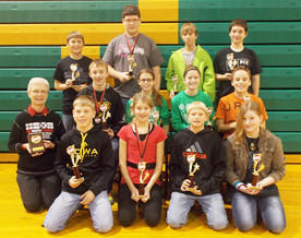 Roncalli hosted a Mathcounts competition for seventh- and eighth-graders on Nov 14. The team winners for eighth grade were, back row from left: Holgate, third place ¿ Kyle Albee, John Prosper, Lincoln Schanzenbach and Daniel Sharp. Middle row, from left: Northwestern, second place ¿ Derek Boekelheide, Josei Clemen, Darby Duncan and Christian Warken. Front row from left, Groton, first place ¿ Coach Darlyne Johnson, Kelby Hawkins, Gabrielle Kramer, Landon Marzahn and Kari Papas.