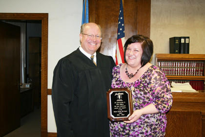 Lori Ehlers, right, Brown County deputy states attorney, was recognized with a plaque by magistrate court judge Mark A. Anderson in appreciation of her efforts for and on behalf of the Brown County DUI Court. As a founding member of the program, Ehlers was instrumental in the establishment of the program. The Brown County DUI Court is a specialized court providing intensive substance abuse treatment and case-management for nonviolent criminal offenders. The court integrates drug and alcohol treatment services with justice system case-processing. Ehlers is assuming new duties as a prosecutor in Minnehaha County.