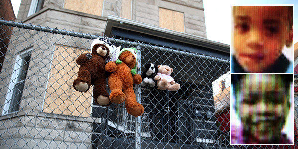 A memorial of stuffed animals is outside the house where  Javaris Meakens, 2, top, and Jariyah Meakens, 3, died.