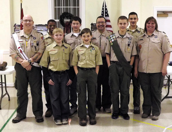Members of Boy Scout Troop 412 are, front row, from left, Logan Toms, Holden Strausser, Ryan Maguire and Michele Taylor (assistant scoutmaster). Back row, Bill Taylor (scoutmaster), Kole Faokunla, Aaron Haden, Niel Augustine (chaplain) and Braydon Strausser.