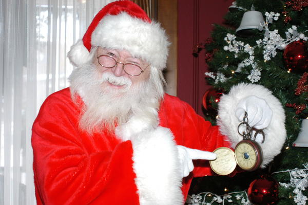 "Santa Claus shows off his ""magical watch"" he says stops time so that he can make it to every house to deliver presents the night before Christmas."