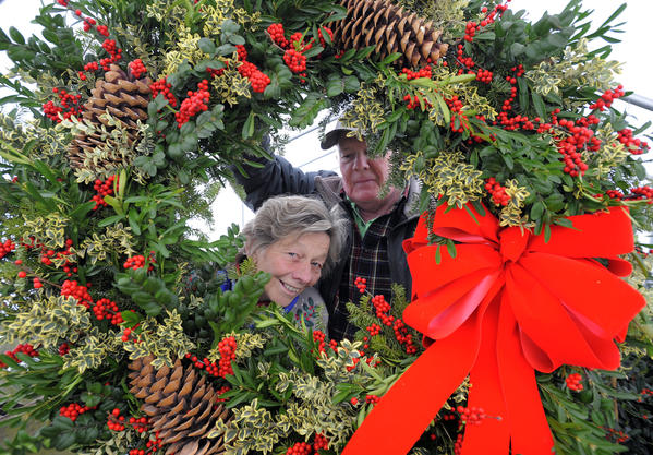 McLean Nurseries in Parkville grows many varieties of holly trees that they use for wreaths and other holiday decorations. proprietor Bill Kuhl, 69 and Miriam Miceli (L) work at the nursery and they are pictured looking through a large wreath that Miriam has made for a client.