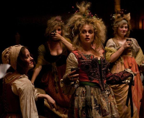 "Helena Bonham Carter, center, lavishly costumed in ""Les Miserables."""
