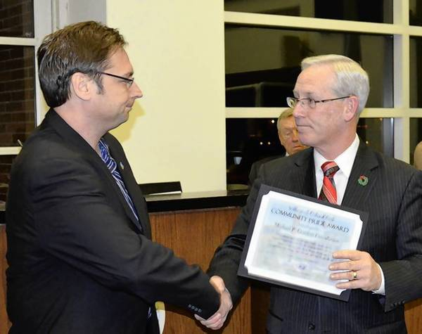 Orland Park Mayor Dan McLaughlin presents a certificate of appreciation to John Gordon of the Michael P. Gordon Foundation.