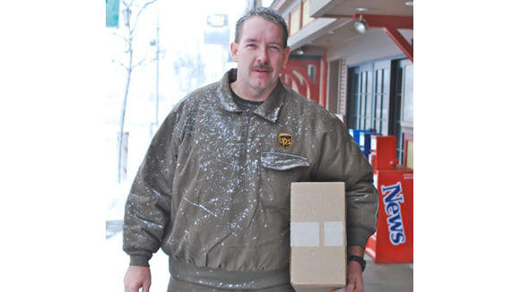 Seasonal UPS delivery person George Zanornacky, was hurrying to deliver packages during the early stages of the area's first winter storm, but paused just long enough to have his picture taken on West Main Street.