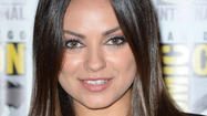 Ashton Kutcher, Mila Kunis cuddle up in Iowa for the holidays