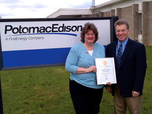 Julie M. Barr-Strasburg, community chapter executive of the Washington and Western Potomac Edison chapters of the American Red Cross, Chesapeake Region, presents David Kline, external affairs manager for Potomac Edison, with a certificate of appreciation in recognition of outstanding financial support to assist with efforts to aid Marylanders affected by Hurricane Sandy.