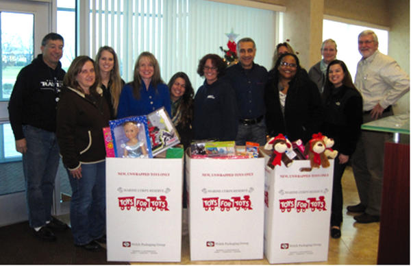 Sierra Nevada Corp., Integrated Mission Systems in Hagerstown held a Toys for Tots drive. Employees shown from left are Dave R., Linette E., Amanda D., Cindy P., Jessica S., Deb H., Ali D., Tiffany B., Andrea E., Linda M., Deb V. and Daryl F.