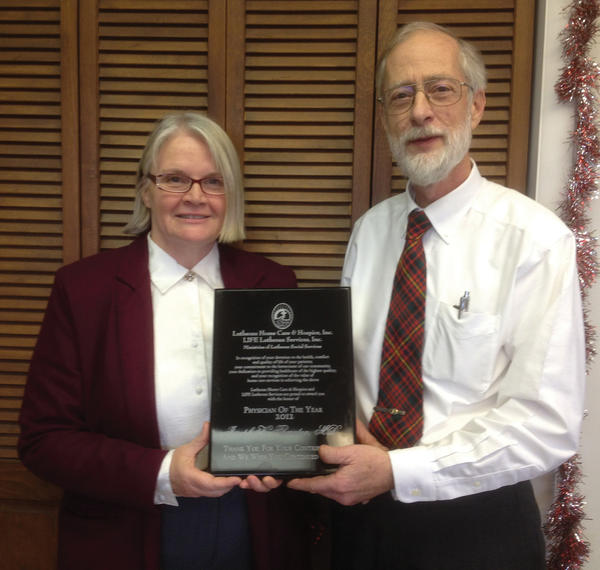 Terry Shade, left, executive director for Lutheran Home Care & Hospice, presents the agency's 2012 Physician of the Year Award to Dr. Joseph Thornton.