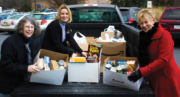 Patients generously gave to this year's I Care food drive. From left, Kris Culler, Candace Miller and Donna Bender, staff from Ludwick Eye Center, load donations to deliver to local food pantries.