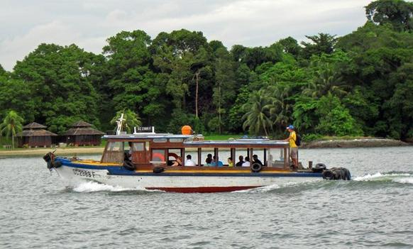 A bumboat makes its way to Pulau Ubin, Singapore. The island is one of the few places in the city-state where nature runs unfettered. About 20% of the vegetation there is mangrove forest, and there's also Singapore's only off-road biking course.