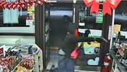One of three armed robbers runs into a Hollywood 7-Eleven.