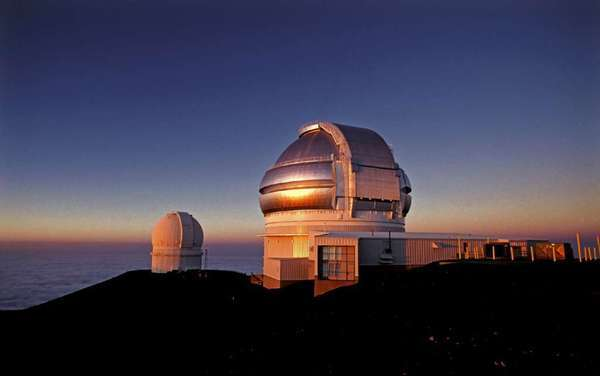 The Gemini telescope sits atop the summit of Mauna Kea, a dormant volcano, at sunrise. The Gemini North telescope has picked up signs that a giant asteroid won't be hitting Earth in 2040. Earlier analyses suggested it might be possible.