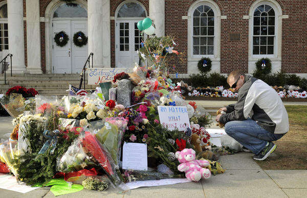 Erik Johannsen of Dover, Md., stopped by the Newtown Town Hall to place a bunch of stuffed animals on a memorial created to honor the 26 women and children killed Dec. 14 at Sandy Hook Elementary School. Johannsen, a member of the Air Force in Dover and a volunteer firefighter, stopped on his way to New Hampshire to be with family on Christmas Eve. The stuffed animals were collected on the base.