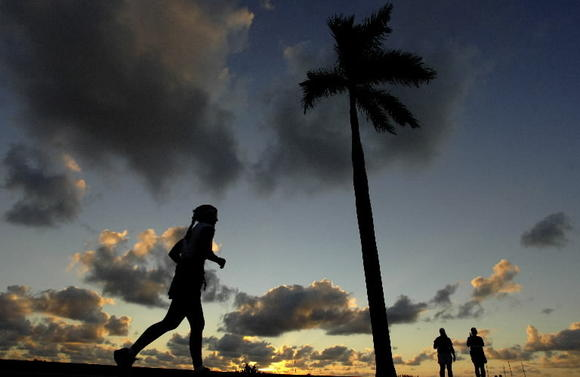 A runner before dawn in West Palm Beach.