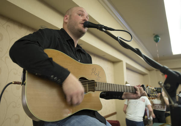 Brian Xander of Schnecksville entertains the crowd during the Spirit of the Lehigh Valley luncheon in the Holiday Inn Conference Center in Upper Macungie Township on Monday.